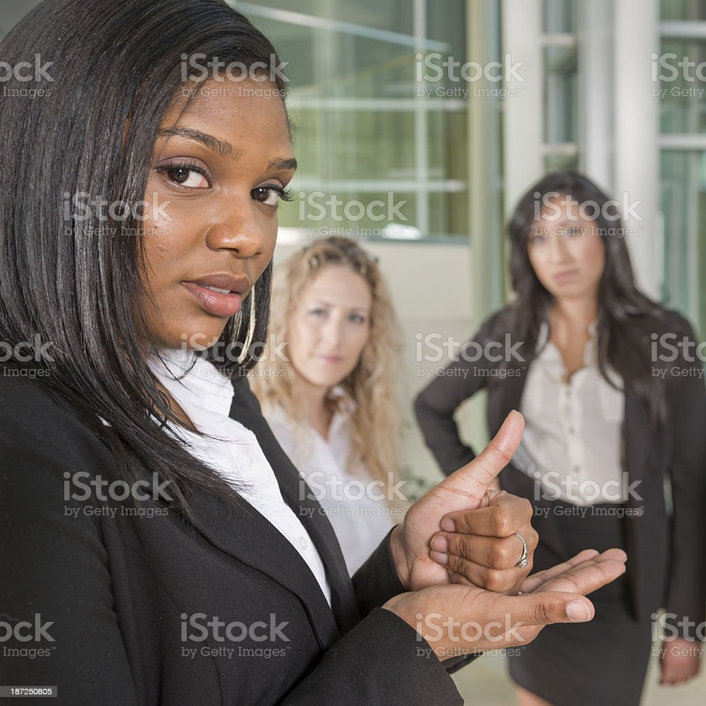 Woman signing the word help in American Sign Language stock photo