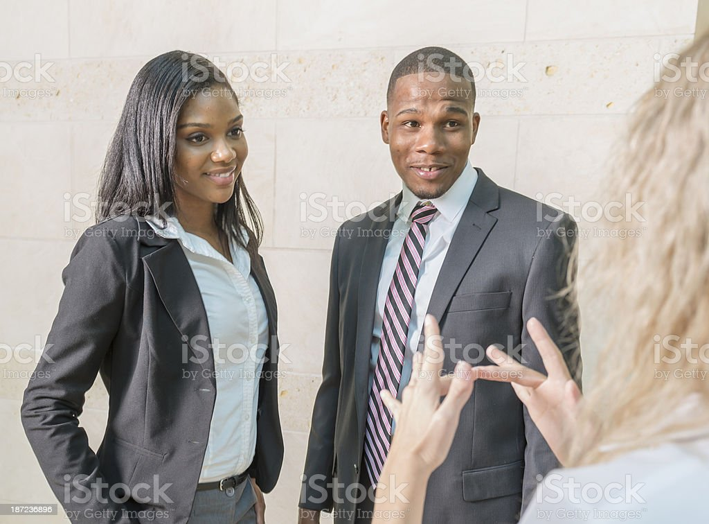 Woman signing to young couple stock photo