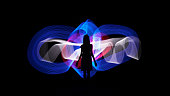 Photo of Woman silhouette against blue, white and red abstract backlight. Light painting photography. Long exposure