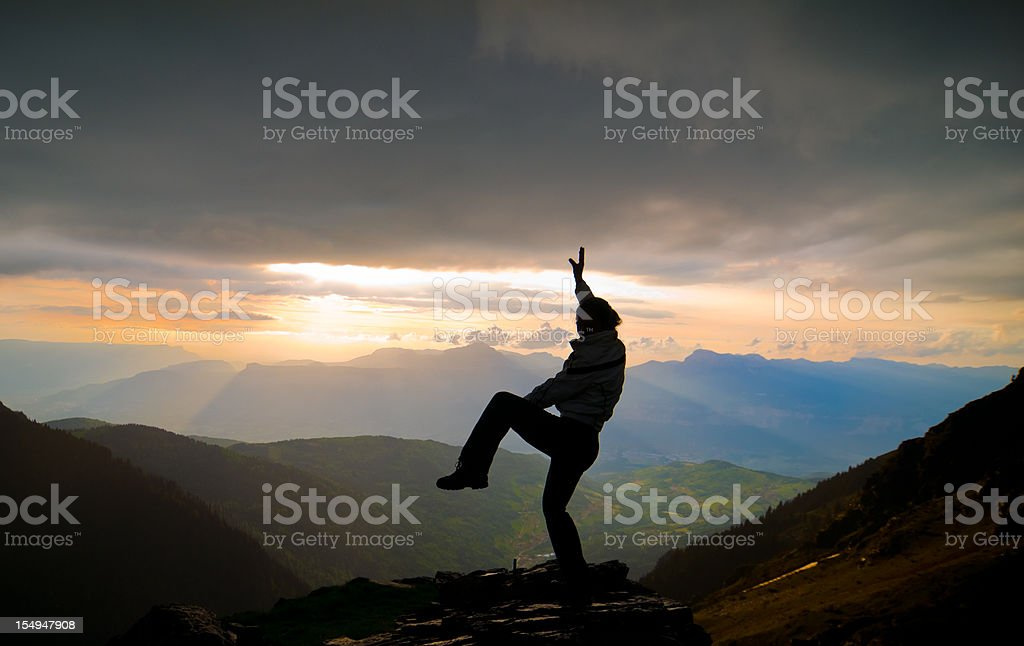 Woman Silhouette against Spectacular mountain landscape royalty-free stock photo