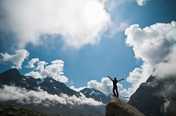 Woman Silhouette against Spectacular mountain landscape stock photo