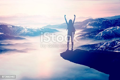 istock Woman Silhouette at sunset on hill 872663462