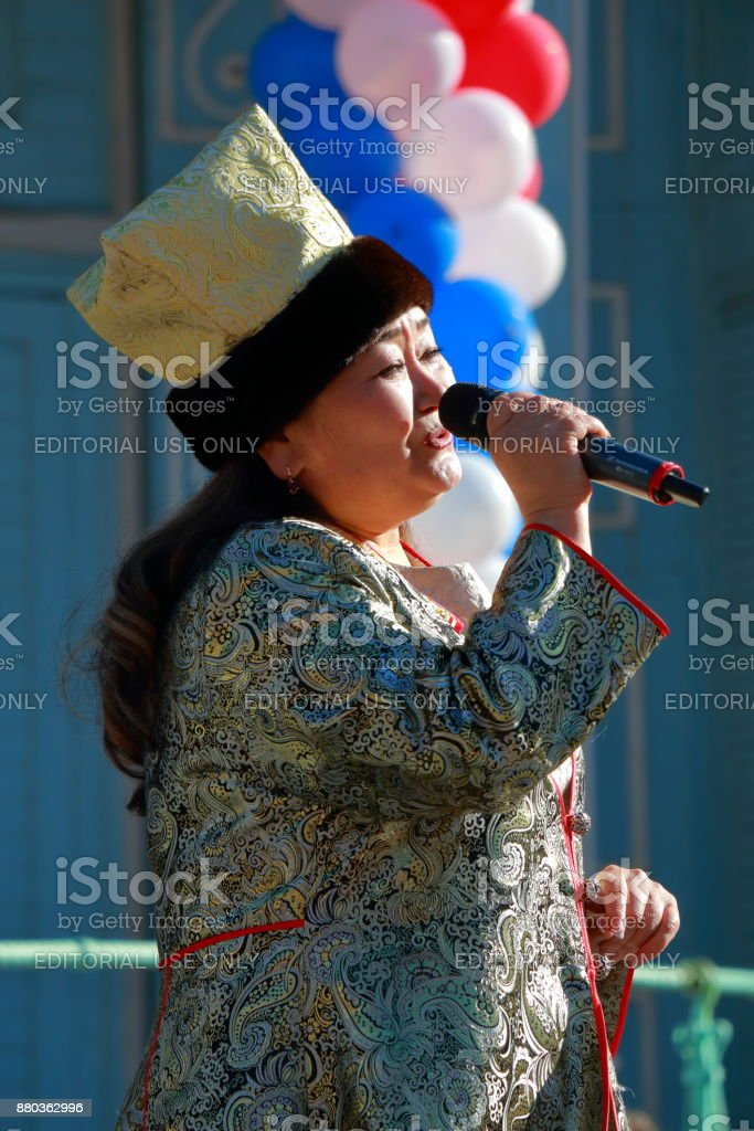 Woman sings the song. National Unity Day in Russia stock photo