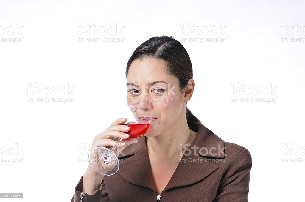 Woman sipping wine royalty-free stock photo