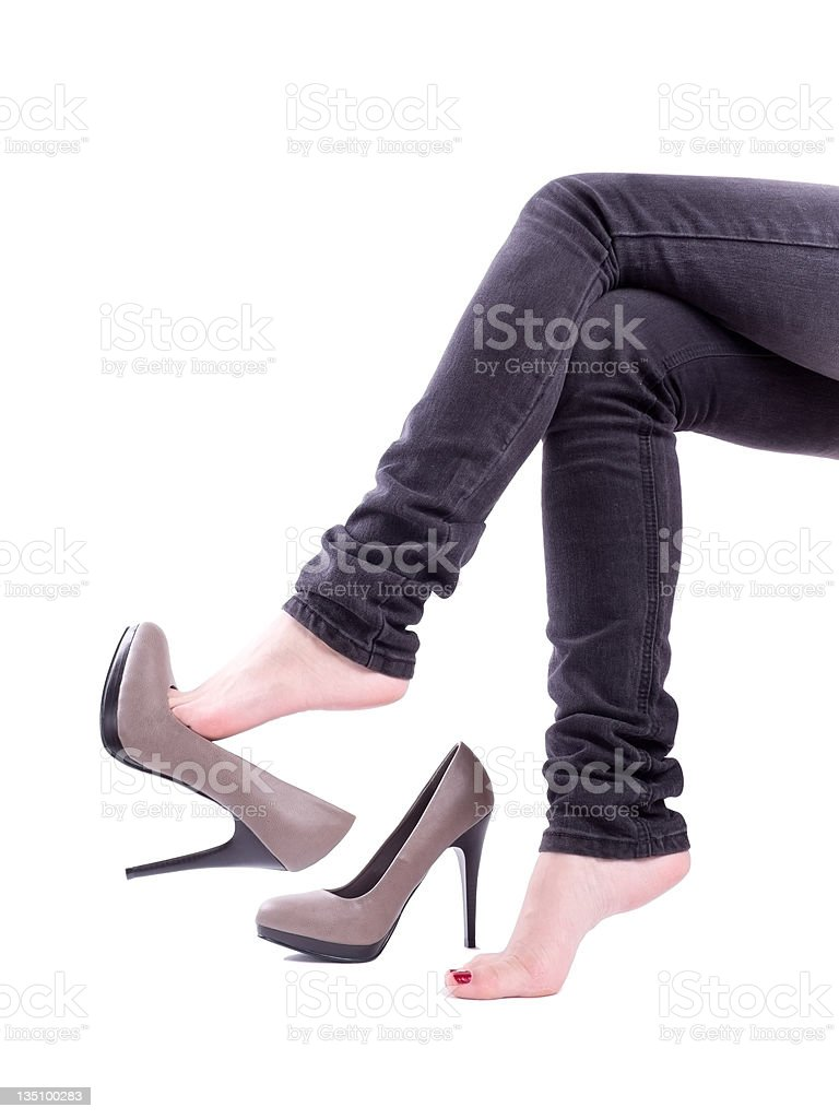 Woman sit and took off her shoes royalty-free stock photo