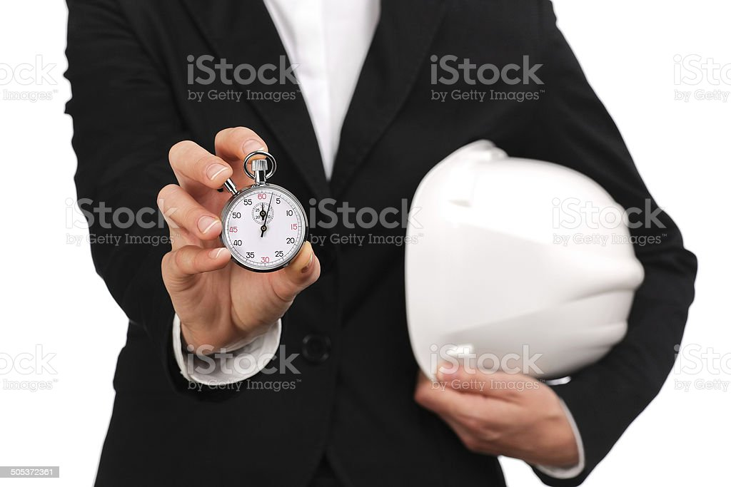 woman site manager holding a stopwatch stock photo