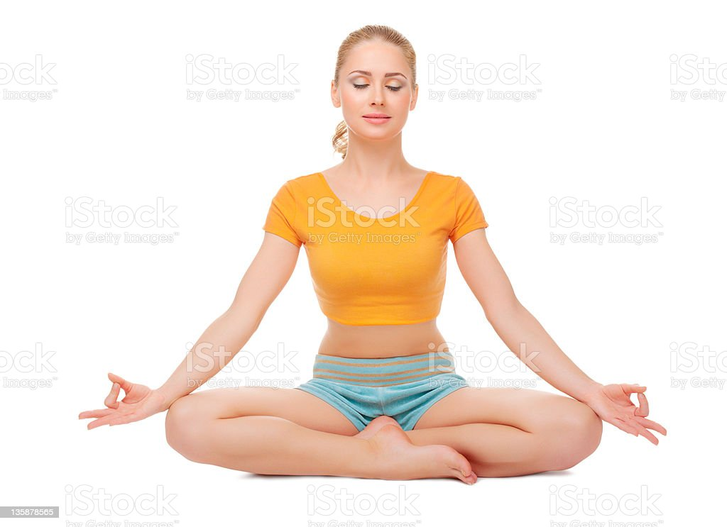 Woman sits in a lotus pose stock photo