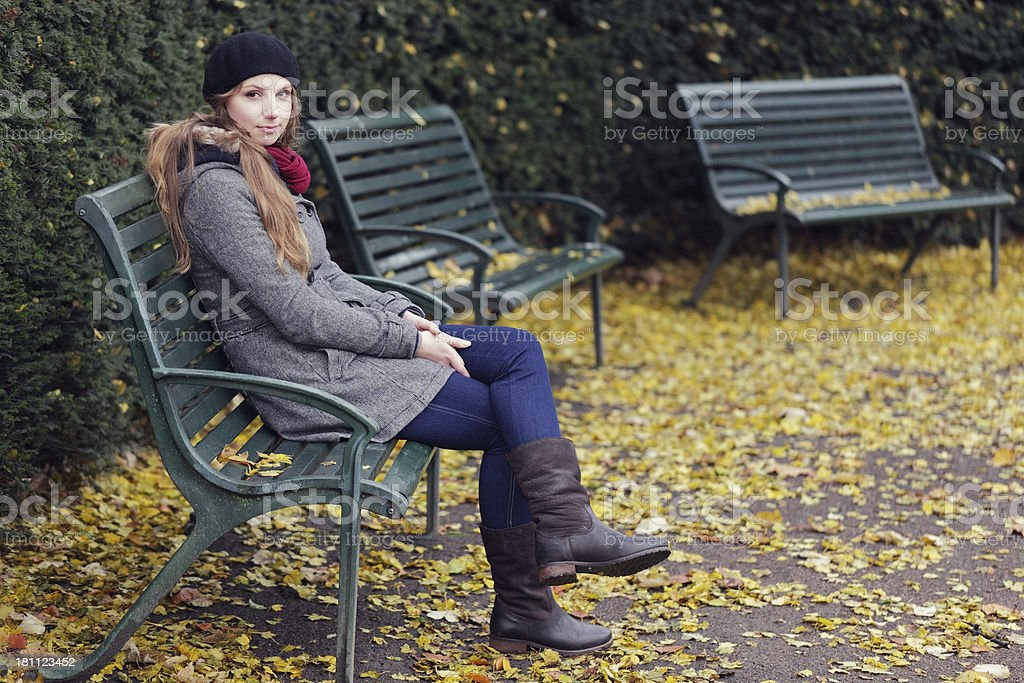 Woman sits outdoors in Autumn royalty-free stock photo