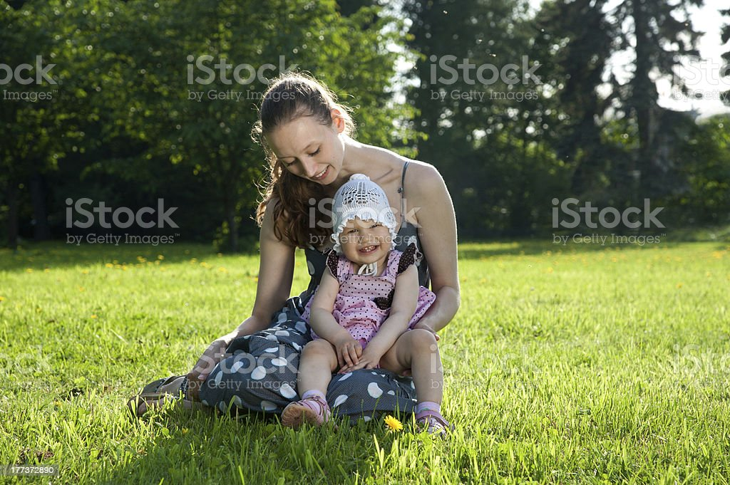 Woman sits with a daughter stock photo