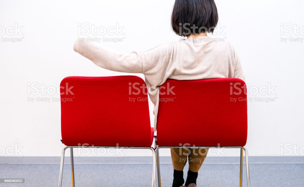 Woman sitting alone stock photo