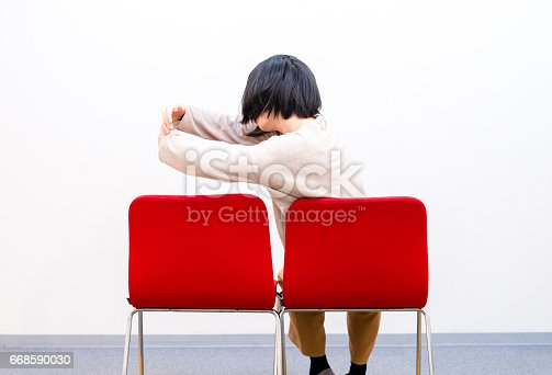 1125634038 istock photo Woman sitting alone 668590030
