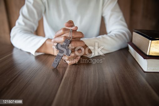 A woman sitting and reading the bible And pray for God's blessing with faith in His power The idea of faith in the sacred power of God through prayer to Him Christianity, Jesus