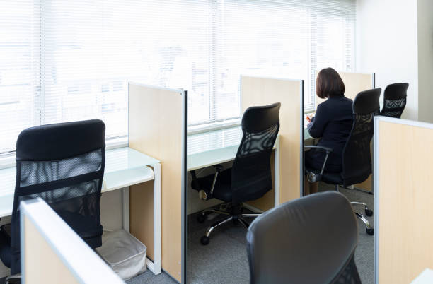 Woman sitting at desk and working stock photo