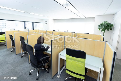 Woman sitting at desk and working