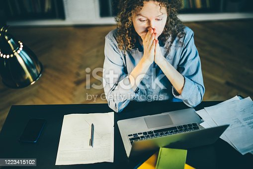 692461598 istock photo woman sitting at desk and working 1223415102