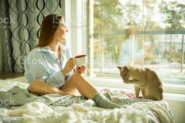 Woman sitting at home a bed by the window picture id1077229272?b=1&k=6&m=1077229272&s=612x612&h=qbvamijkyol onklld jxdgzw2nb6qx4e 6zf2sl8rq=