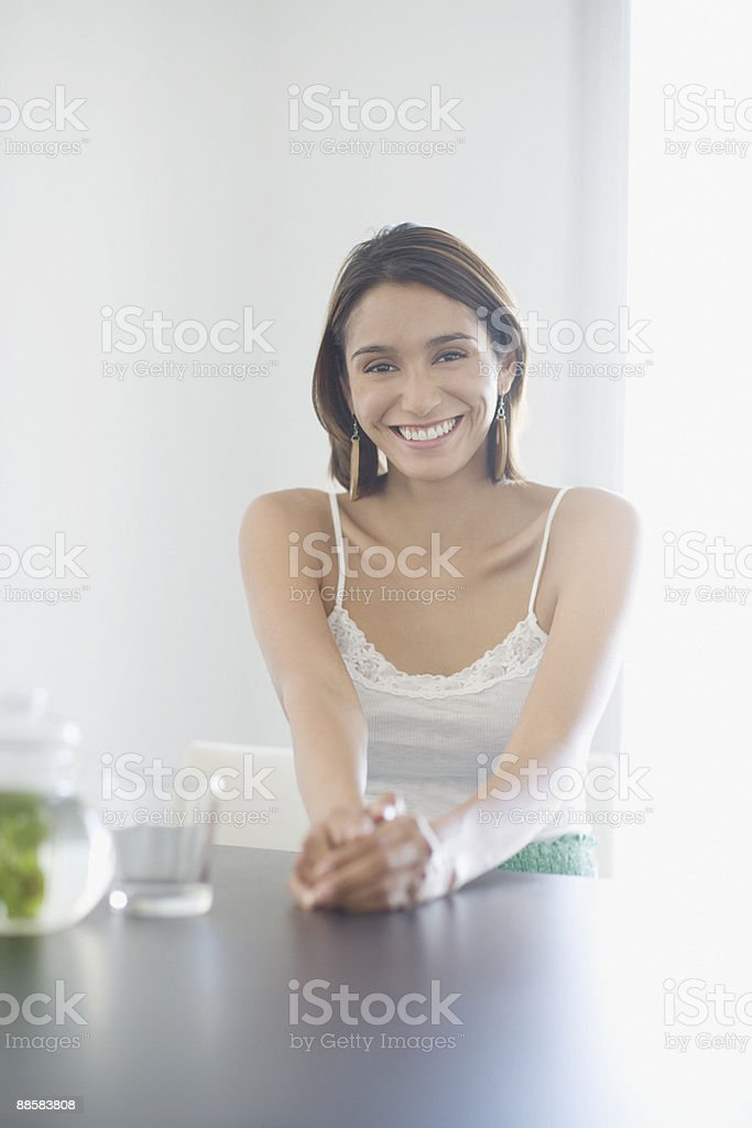 Woman sitting at table royalty-free stock photo