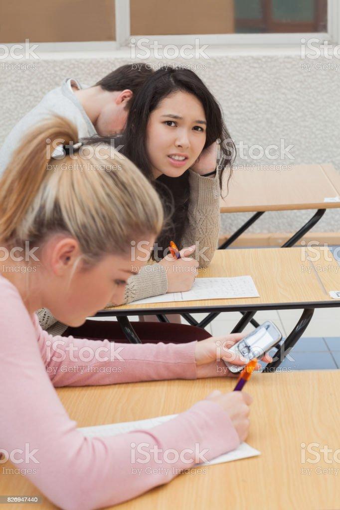 Woman sitting at the desk needing help stock photo