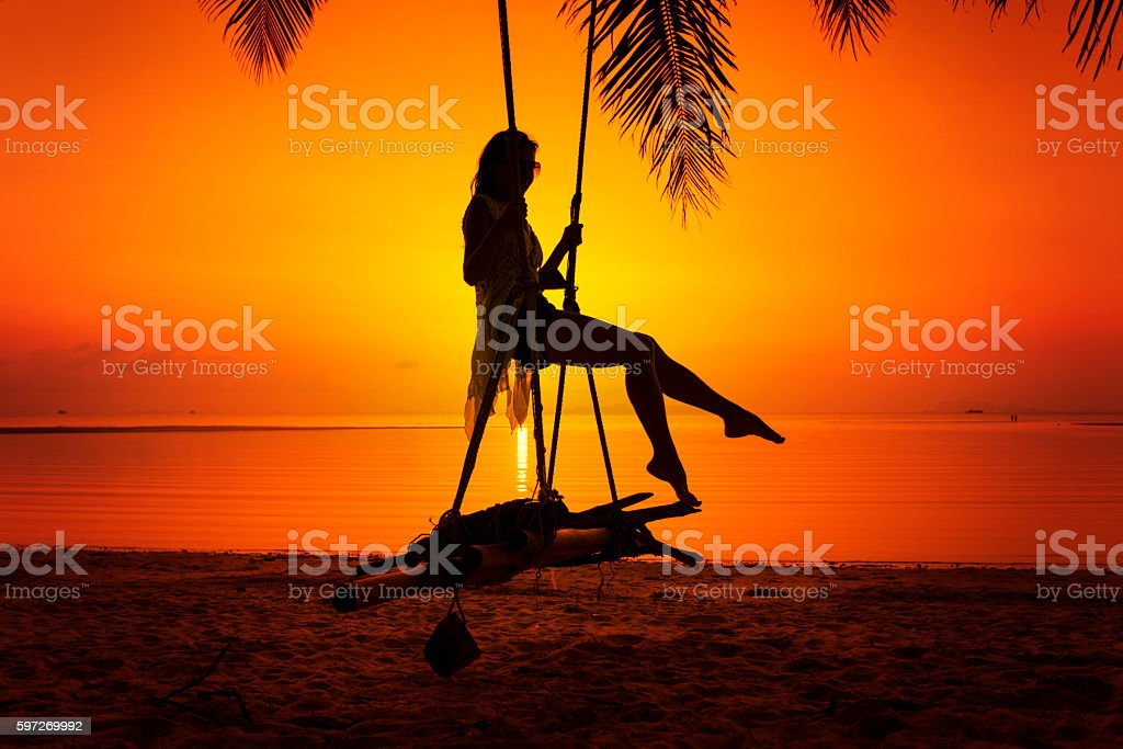 Woman sitting at tropical swing royalty-free stock photo