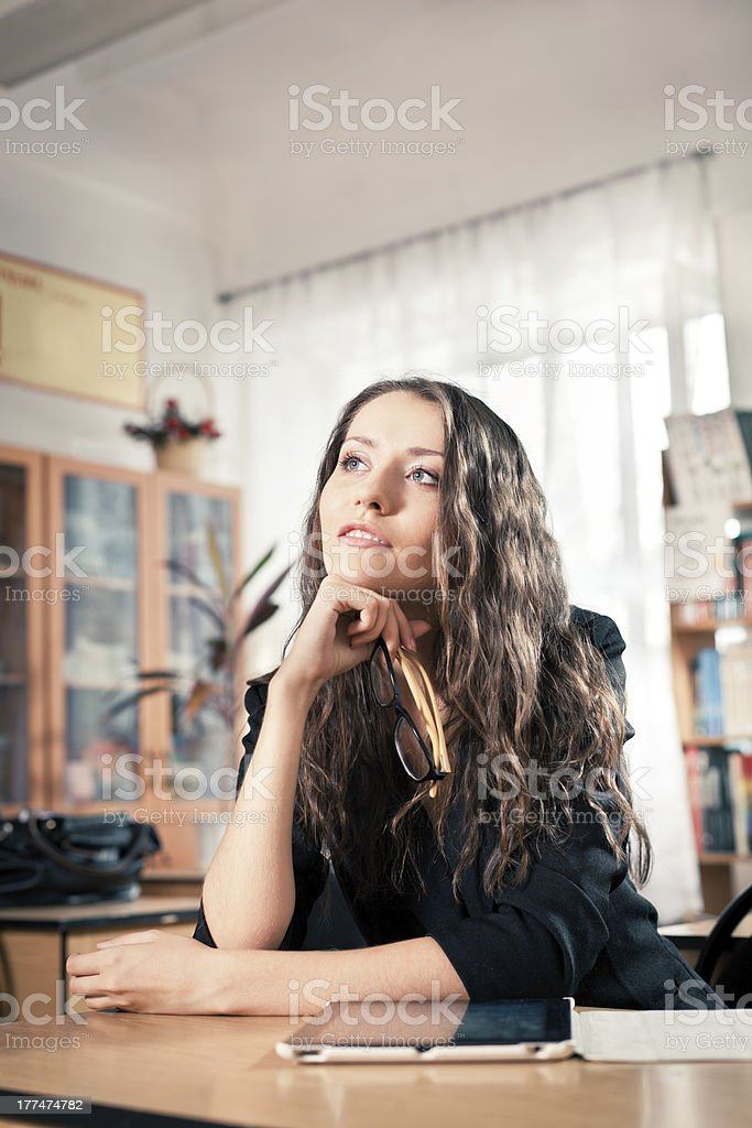 woman sitting behind the desk at library royalty-free stock photo