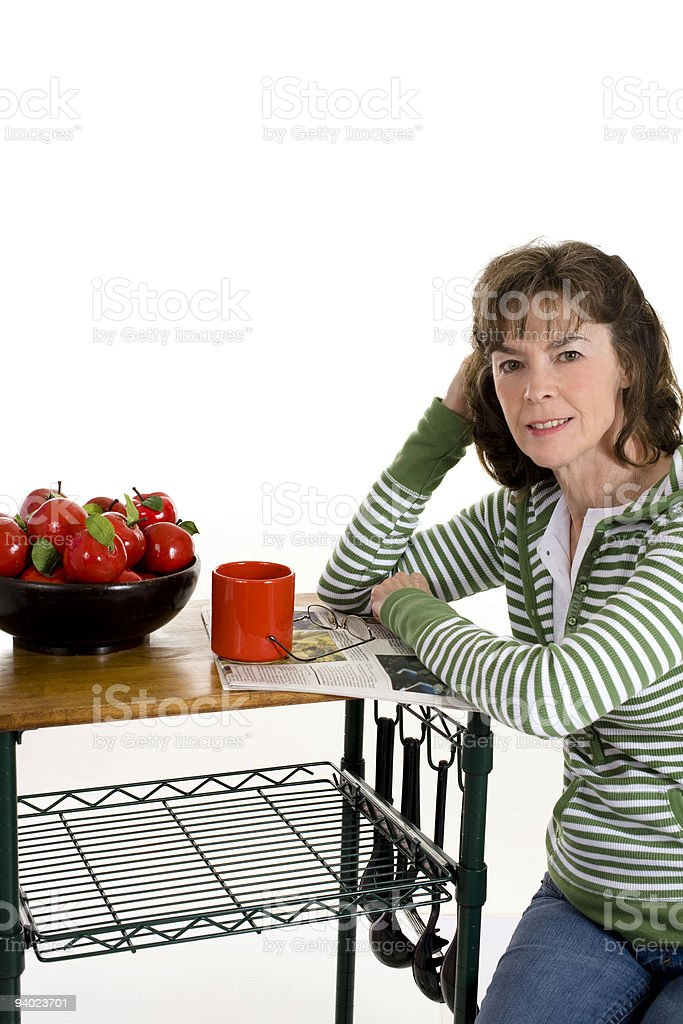 Woman sitting by kitchen cart. royalty-free stock photo
