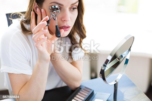 istock Woman sitting by the mirror 682965634