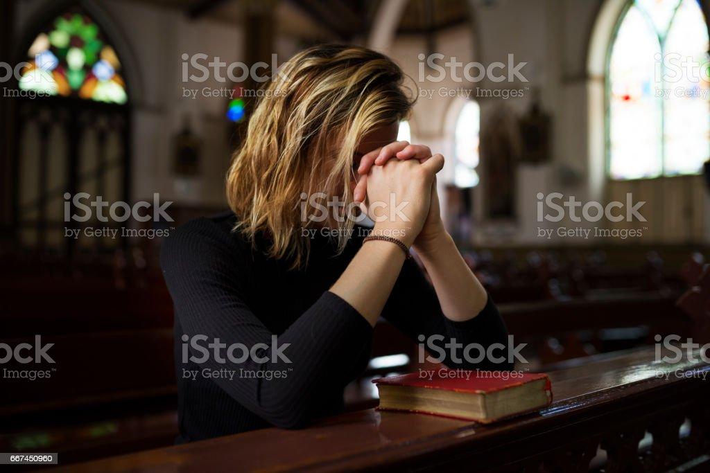 Woman Sitting Church Religion Concept stock photo