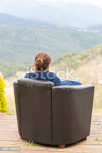 istock Woman sitting in a armchair 532126816