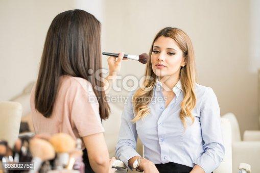 istock Woman sitting in a beauty salon 693002752
