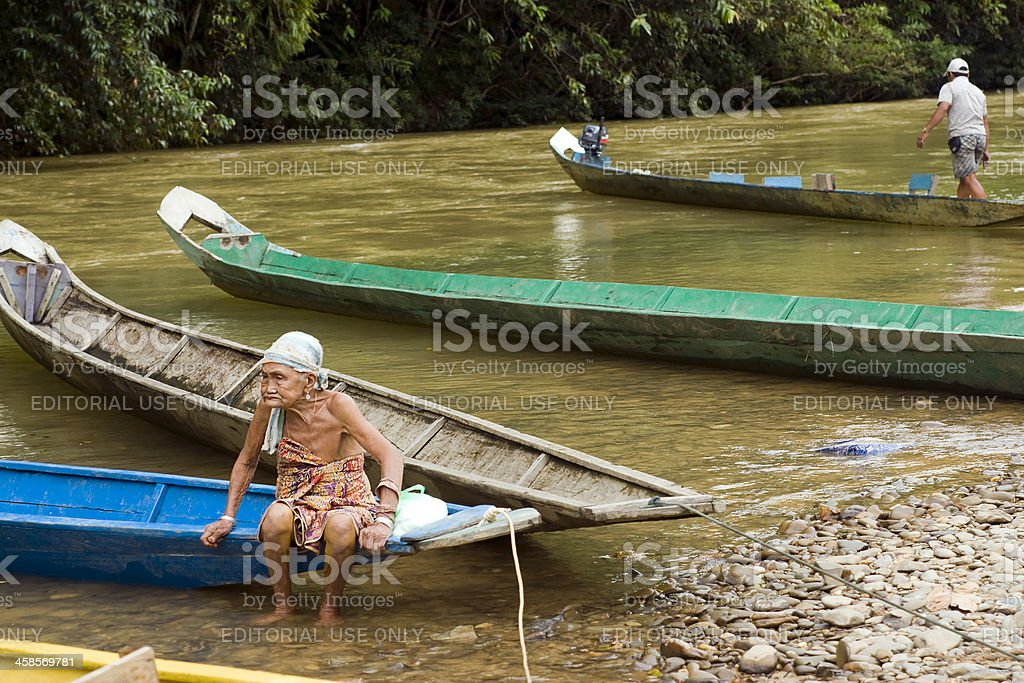 Woman sitting in a boat on Sarawak River stock photo