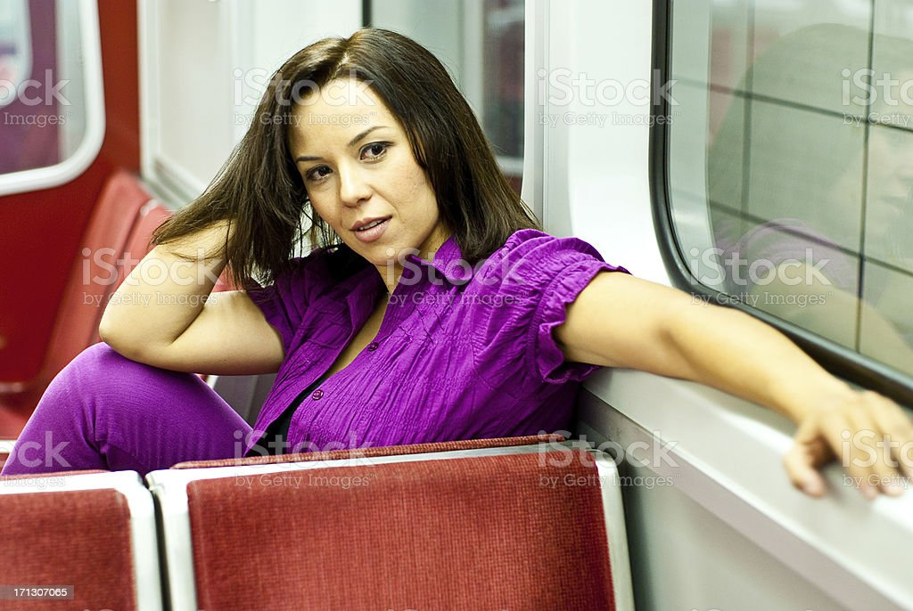 Woman Sitting in a Sub Way Car royalty-free stock photo
