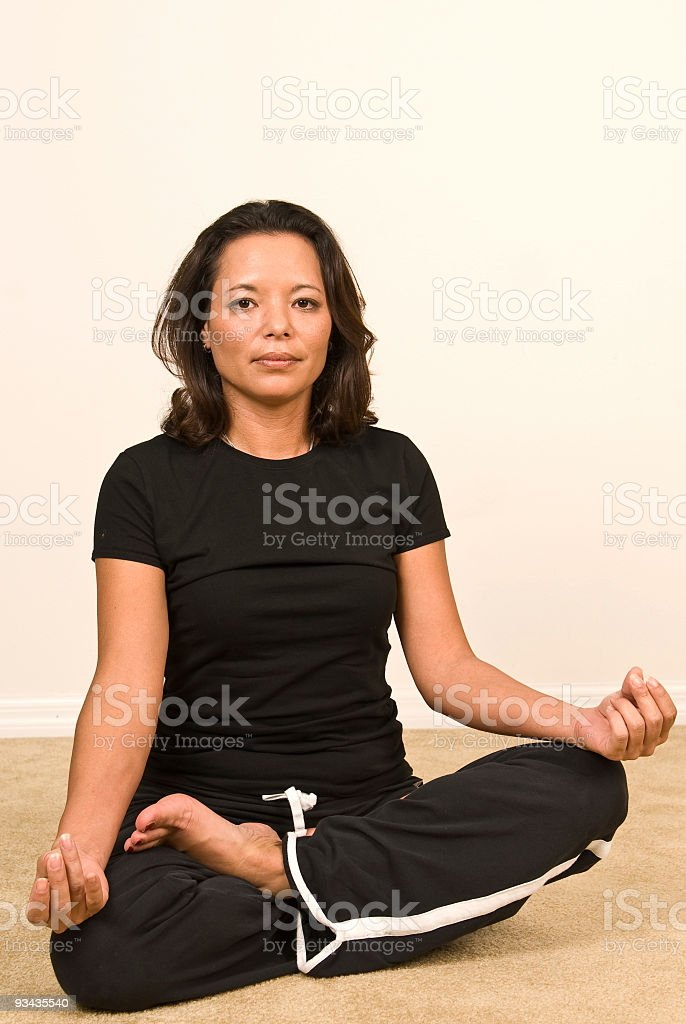 Woman sitting in a yoga pose royalty-free stock photo