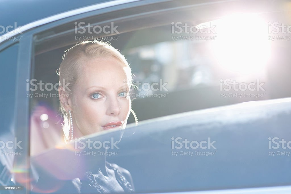 Woman sitting in backseat of car royalty-free stock photo
