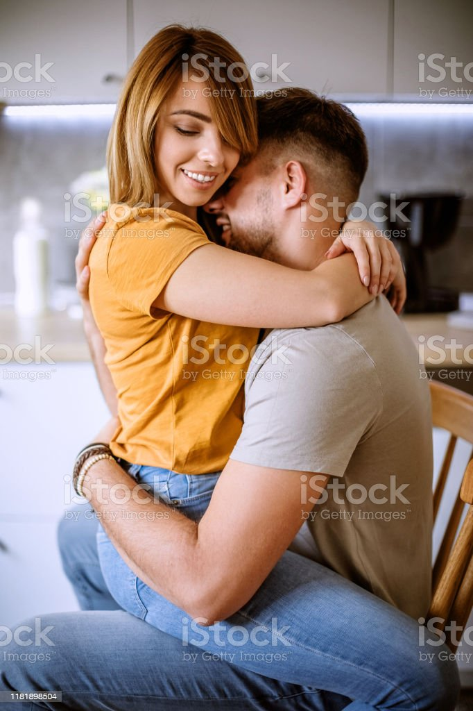 Woman Sitting In Boyfriends Lap And Embracing Stock Photo Download Image Now Istock