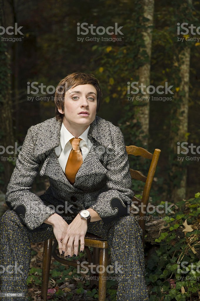 Woman Sitting in Chair stock photo