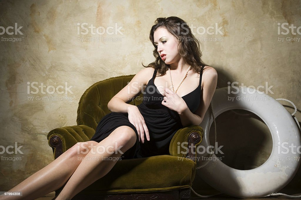Woman sitting in chair with lifesaver royalty-free stock photo