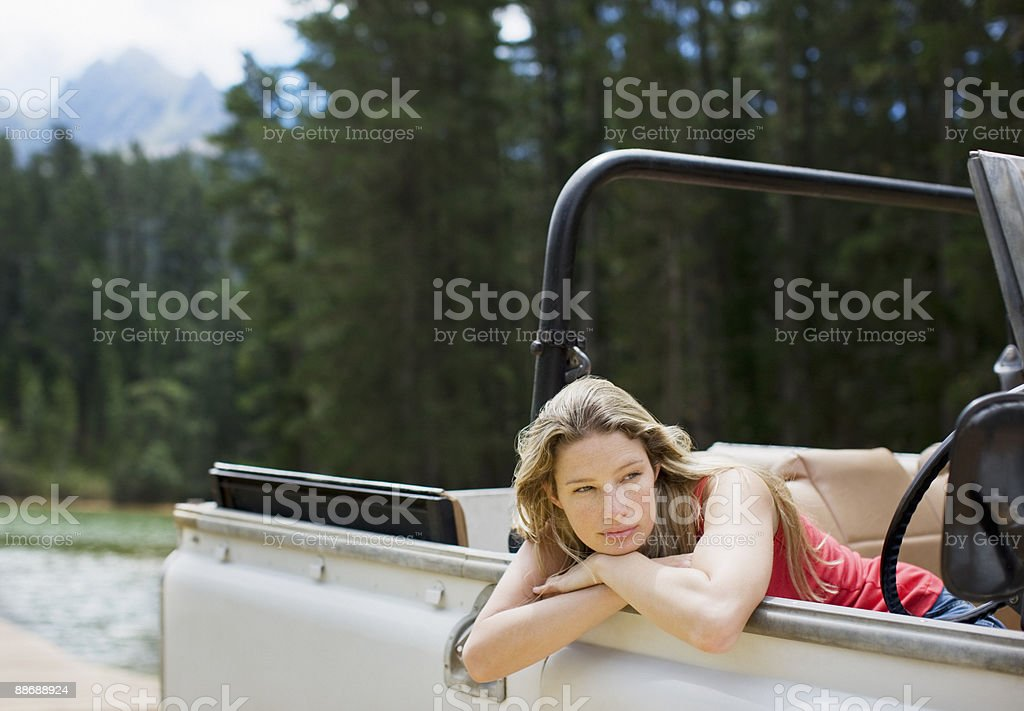 Woman sitting in jeep royalty-free stock photo