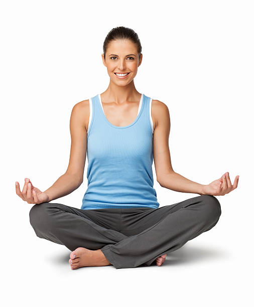 Woman Sitting In Lotus Position - Isolated stock photo