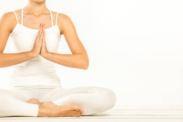 frau sitzt in lotus position - kundalini yoga stock-fotos und bilder