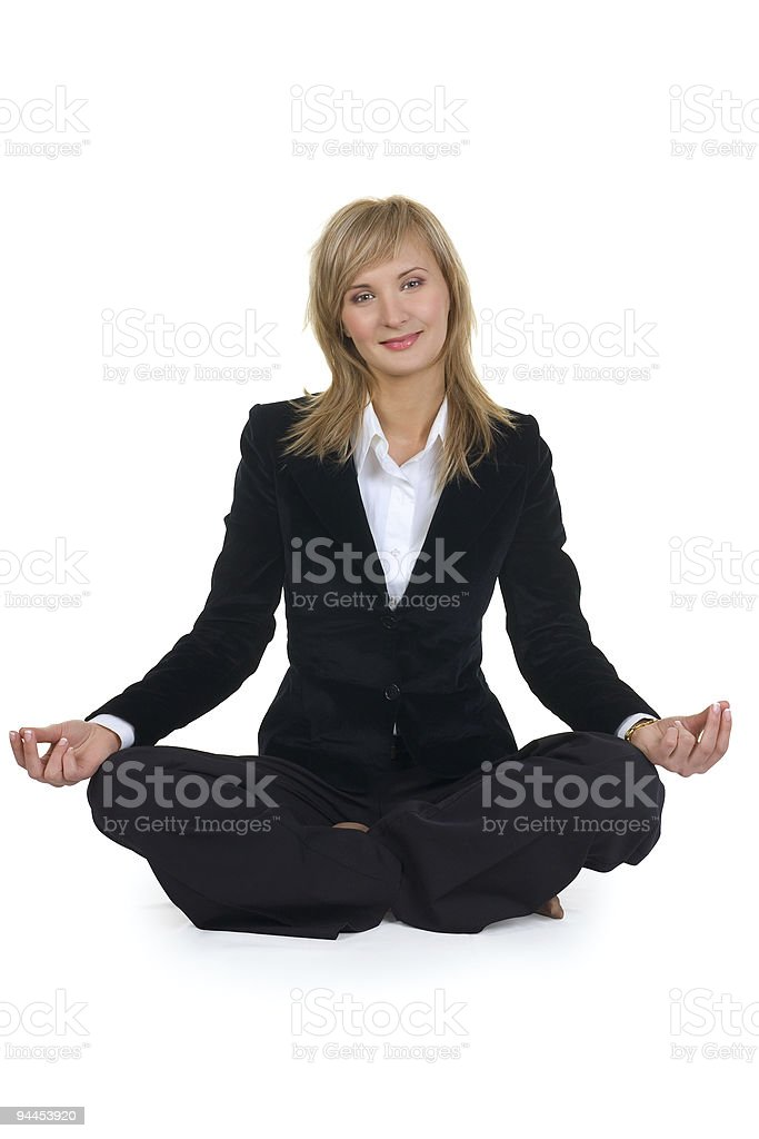 Woman sitting in lotus position royalty-free stock photo