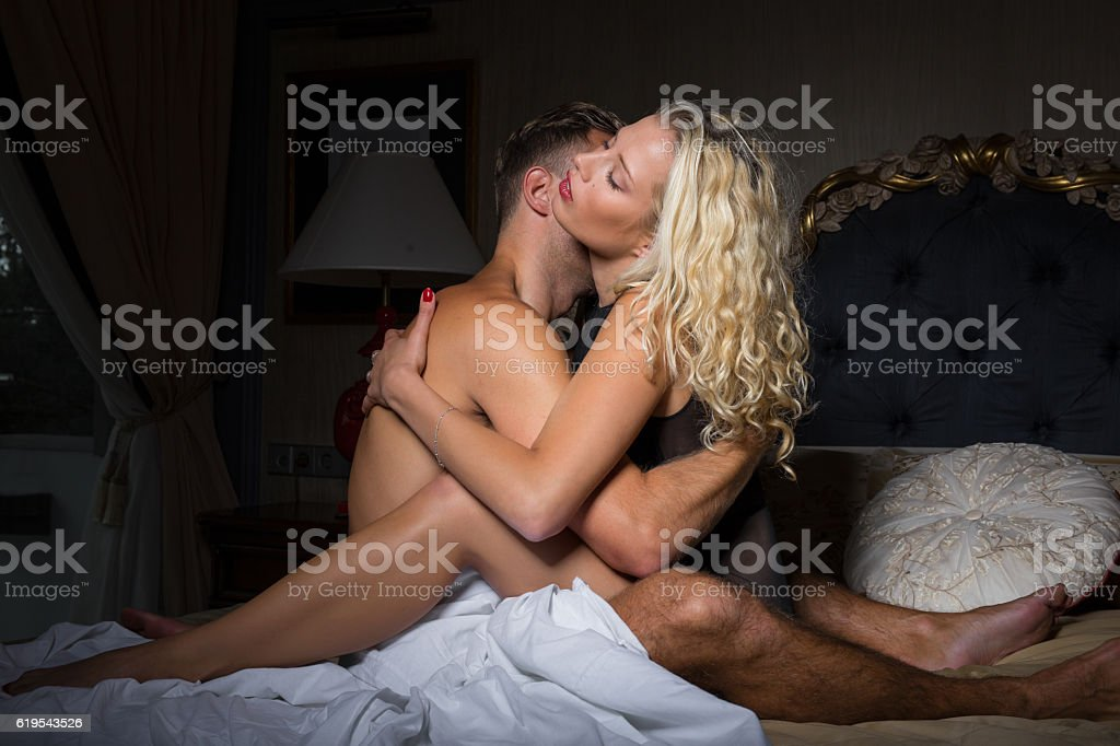 Woman sitting in mans lap stock photo