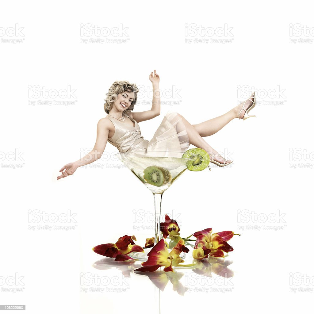 Woman Sitting in Martini Glass royalty-free stock photo