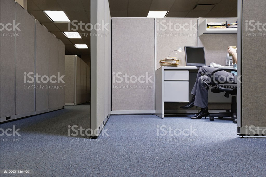 Woman sitting in office, low section royalty-free stock photo