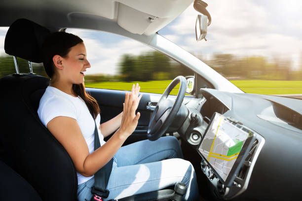 Woman Sitting In Self Driving Modern Car stock photo
