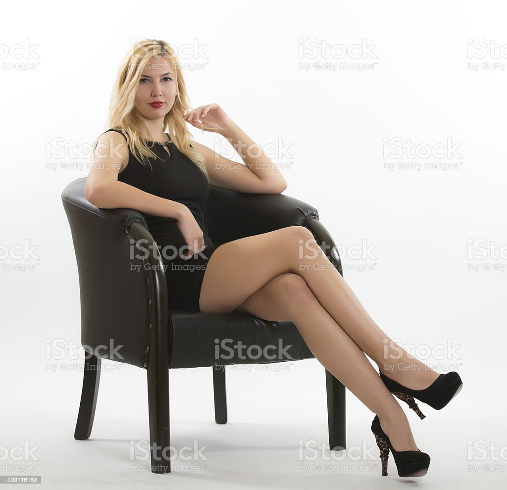 Woman Sitting On A Black Chair Stock Photo Amp More Pictures