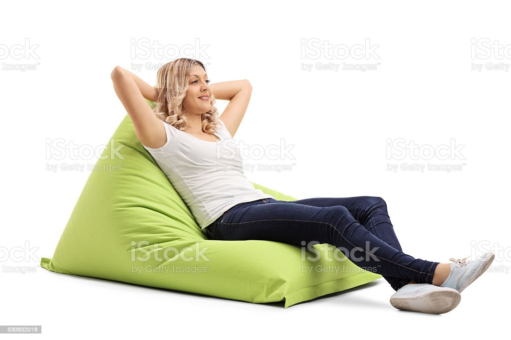 Woman sitting on a comfortable beanbag stock photo