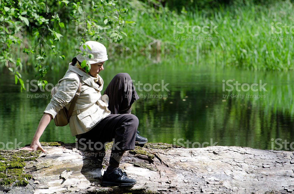 Woman sitting on a tree royalty-free stock photo