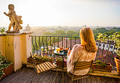 istock Woman sitting on balcony in early morning 970204070