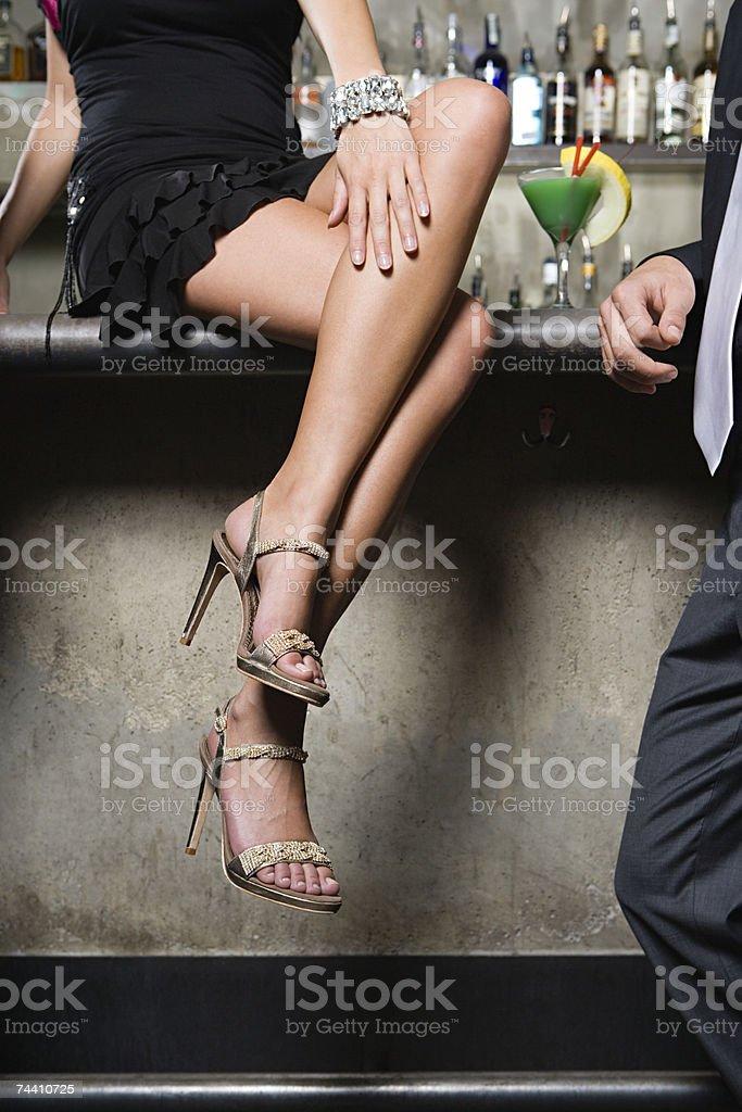 Woman sitting on bar stock photo