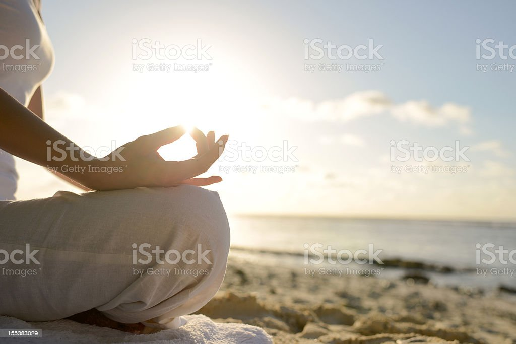 Woman Sitting On Beach With Yoga Lotus Position royalty-free stock photo